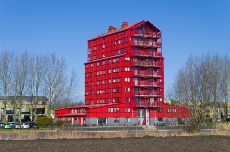 figuring: modern red apartment in Almere, Netherlands. They are called red thunders and figuring the transition from the outer residential areas to the agricultural polders
