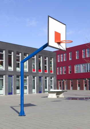 school playground with basketball hoop Stock Photo
