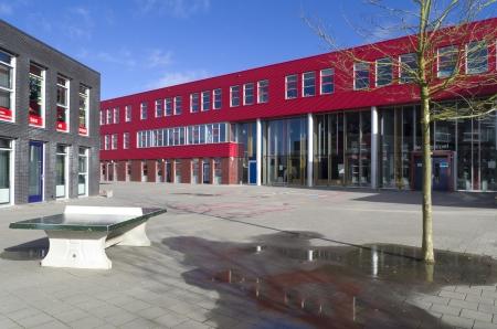 modern school building with playground