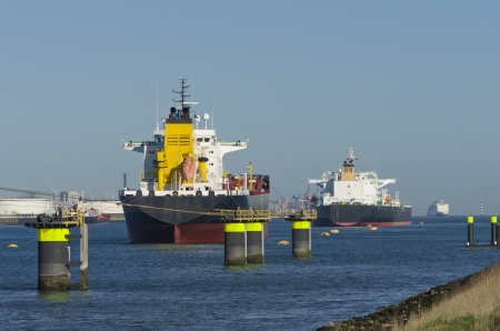 large industrial ships moored in the rotterdam harbor photo