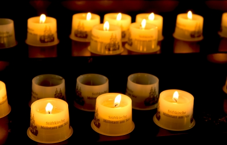 candles in the stiftkirche in millstatt am see, austria Stock Photo - 23241199