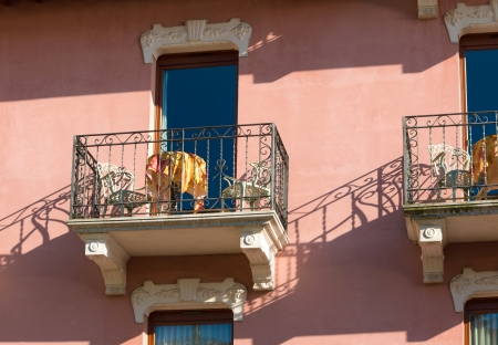 picturesque hotel balconies with table and chairs in a small touristic Italian village photo