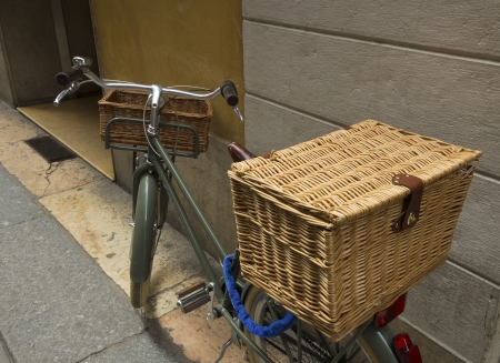 shoppings: ladies bicycle with two reed baskets for carrying shoppings