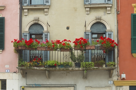 characteristic: characteristic Italian balcony with red flowers