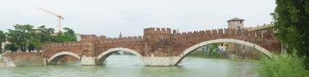 mediaval: panorama of mediaval stone bridge of Scaliger in Verona, Italy. The segmental arch bridge featured the worlds largest span at the time of its construction. Stock Photo