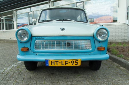 iron curtain: blue vintage trabant car. The East German-made Trabant was the most popular family car in the Eastern block in the 70s and 80s.  3,096,099 trabants were produced in 33 years of production.