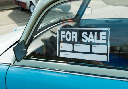 car loans: for sale sign on a car