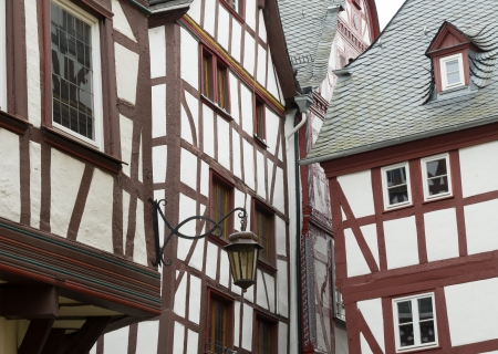 half timbered house: touristic village of Bernkastel-Kues in Germany  The town lies along the Moselle and employs 6,840 people  The town is a tourist attraction in the Moselle valley and consists of two parts  Bernkastel on the right bank and Kues on the left bank  Both parts