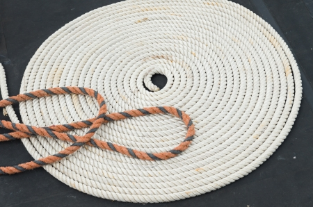 coiled rope: coiled rope on a boat deck