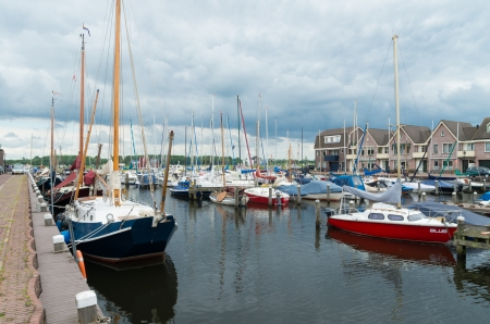 Yachts in Spakenburg harbor in the Netherlands. Spakenburg has always been a fishing village and in 1892 the village had around 200 fishing boats