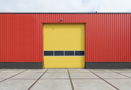yellow roller door in an orange building photo