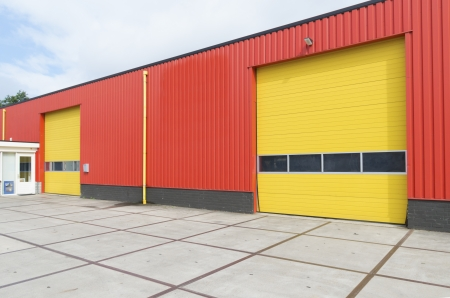 yellow roller doors in an industrial warehouse photo
