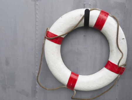 life buoy attached to a metal wall on a ship photo