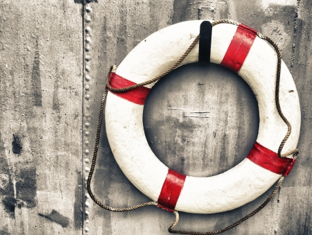 marine life: life buoy attached to a metal wall on a ship