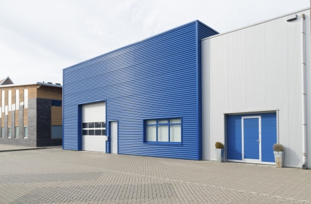 industrial park: facade of a modern blue warehouse