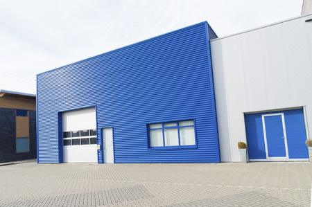 facade of a modern blue warehouse photo