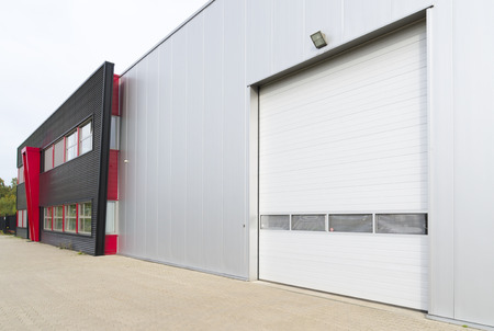 entrance of warehouse with office unit next to it