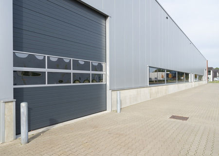 industrial park: entrance of a modern warehouse with roller door