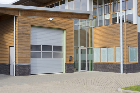commercial real estate: newly build office building with integrated warehouse