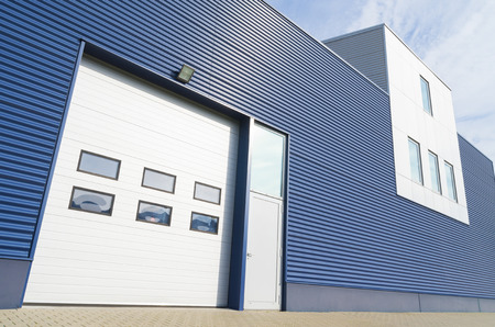 commercial docks: exterior of a modern warehouse with office unit Editorial