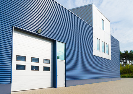 factory buildings: exterior of a modern warehouse with office unit Editorial