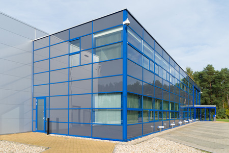 exterior of a modern blue office building