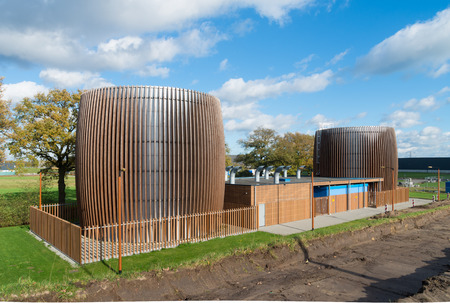 two storage silos modernized with a wooden frame