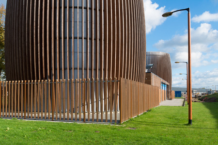 tonne: two storage silos modernized with a wooden frame Editorial