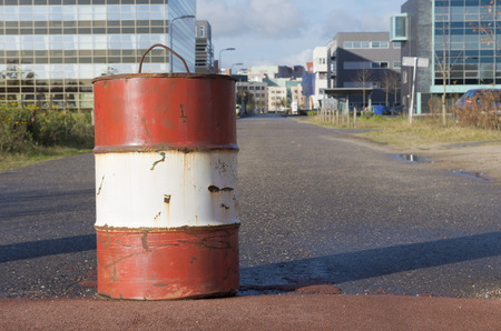 red with white oil barrel used as a road block Stock Photo - 25924383