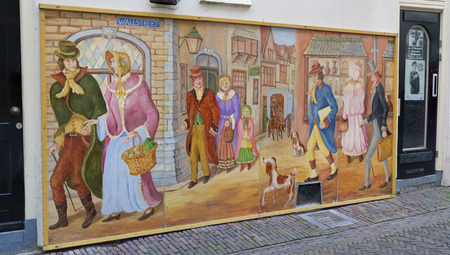 dickens: large charles dickens painting in deventer, netherlands. Each year before Christmas hundreds of characters of the British author, from chimney-sweepers to Ebenezer Scrooge, wandered through the streets.