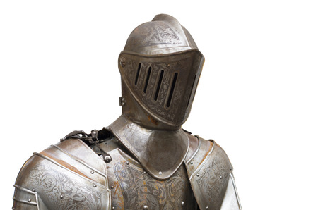 knight helmet: upper part of a medieval full armor suit against a white background