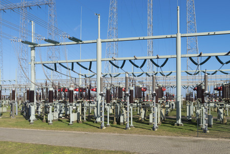 isolator high voltage: detail of a transformer station under a blue sky