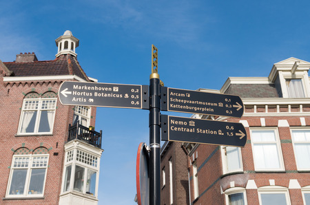 signpost with touristic destinations in the center of amsterdam photo
