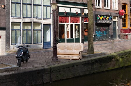 red light district in amsterdam at daylight. Since October 2000, window prostitutes have been allowed to legally ply their trade. Today, prostitutes in the Netherlands are also taxpayers.