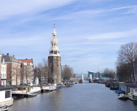 amstel river: view on the famous Munttoren (coin tower) in Amsterdam. It is a tower  which was formerly part of the Regulierspoort. This gate was one of the three main gates of the medieval fortifications of the city.