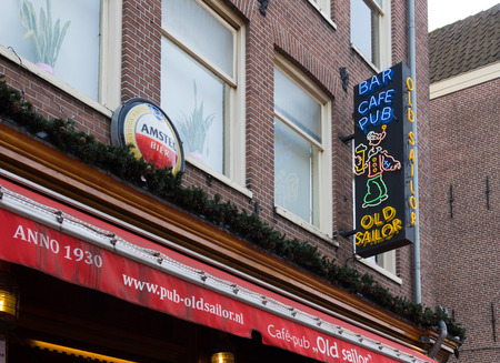 signpost of the Old Sailor pub in the amsterdam red light district. it is one of the most famous bars in the heart of the red light district. Known by tourists and locals. Editorial
