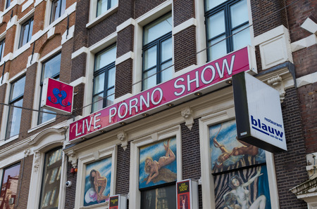 exterior of an amsterdam porno show in the red light district. Prostitution has been legal in the Netherlands since 2000. Before then, prostitution was technically illegal although it was tolerated.