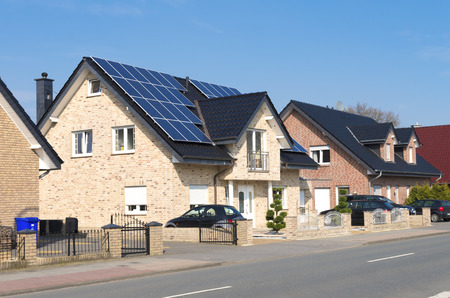 solar roof: modern house with solar panels on its roof