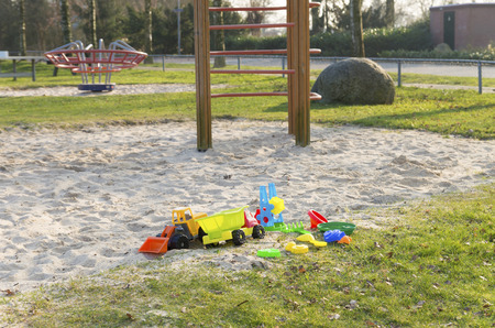 sandpit: empty sandpit with colorful toys
