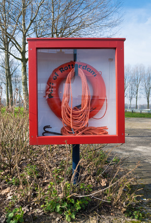 grapnel: safety buoy and a rope with grapnel in the rotterdam harbor Stock Photo