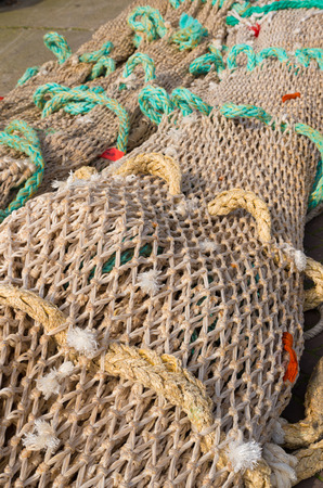 fishing net on the quay of scheveningen harbor in the netherlands photo