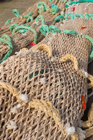 fishing net on the quay of scheveningen harbor in the netherlands photo