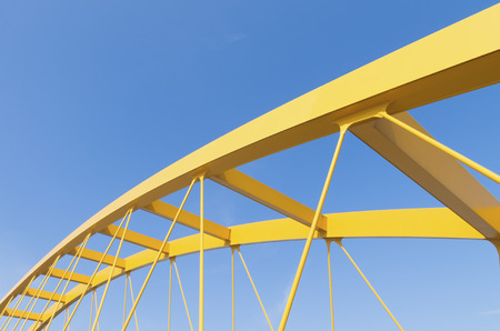 detail of the yellow arch bridge in Utrecht, netherlands. The Hogeweide Bridge is a steel arch bridge over the Amsterdam-Rhine Canal photo