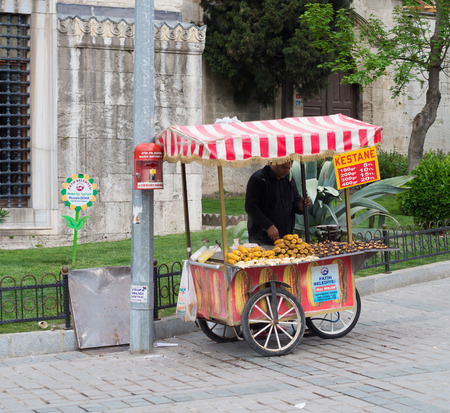 street vendor selling corn and chestnuts in istanbul. Eating on the street is part of local life here