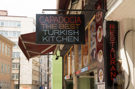 neon sign in front of a restaurant in Istanbul  The dishes are usually based on fresh fruits and vegetables, grilled meat or fish, and many salads