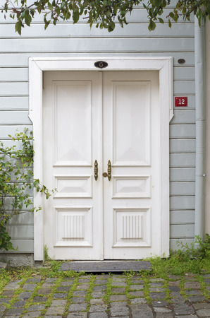 white front door of a wooden house in istanbul, turkey photo