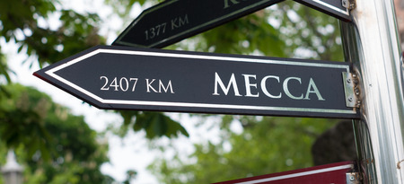 signpost with distance to Mecca in Istanbul, turkey photo
