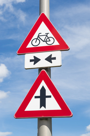 warned: bicycle lane crossing a priority road, warned by traffic signs