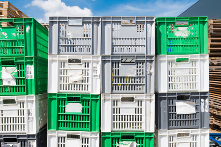piled up empty plastic crates on an industrial area photo