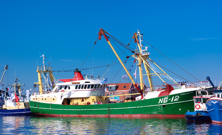 dutch fishing boats in the Urk harbor. Urk has by far the largest fishing fleet and fish processing industry in the Netherlands.